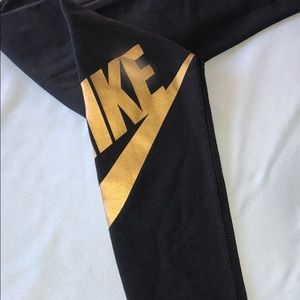 Black/Gold NIKE Leggings. Size small